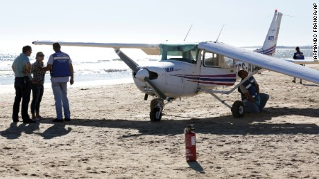 The plane that struck and killed two people on a beach.