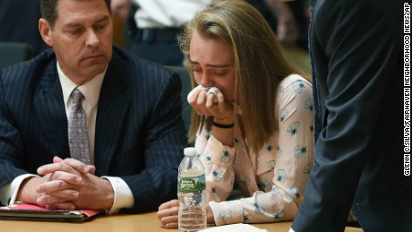 FILE- In this Friday, June 16, 2017, file photo, Michelle Carter cries while flanked by defense attorneys Joseph Cataldo, left, and Cory Madera, after being found guilty of involuntary manslaughter in the suicide of Conrad Roy III in Bristol Juvenile Court in Taunton, Mass. Juvenile Court Judge Lawrence Moniz will sentence Carter on Thursday, Aug. 3. (Glenn C.Silva/Fairhaven Neighborhood News, Pool, File)