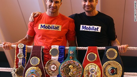 "GOING, AUSTRIA - FEBRUARY 01: Wladimir Klitschko (L) and his brother Vitali Klitschko pose with their championship belts including the ""THE RING"" magazine belt , WBO Super World Champion belt, WBA Superchampion belt, WBC belt, IBF belt and IBO belt during a photocall at Hotel Stangwirt on February 1, 2012 in Going, Austria. (Photo by Alexander Hassenstein/Bongarts/Getty Images)"