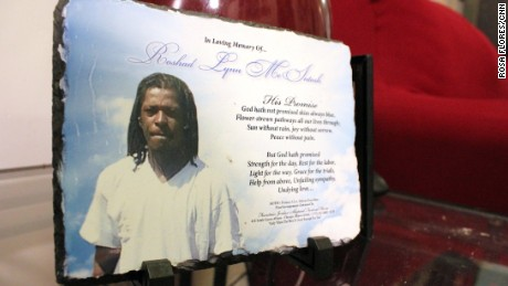 Cynthia Lane keeps this prayer and photo of her son Roshad McIntosh in her living room.