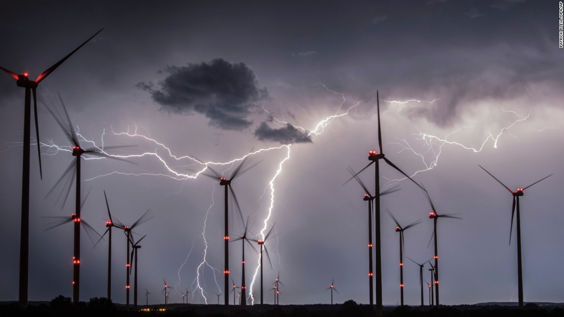 Lightning illuminates the sky over a wind farm in the German district of Oder-Spree on Tuesday, August 1.