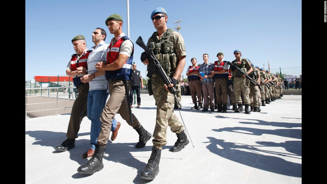 "Defendants are escorted to a courthouse in Ankara, Turkey, on Tuesday, August 1. <a href=""http://www.cnn.com/2017/08/01/europe/turkey-failed-coup-mass-trial/index.html"" target=""_blank"">A mass trial started</a> for nearly 500 people accused of plotting to overthrow the Turkish government last year. The trial is expected to take more than a month."