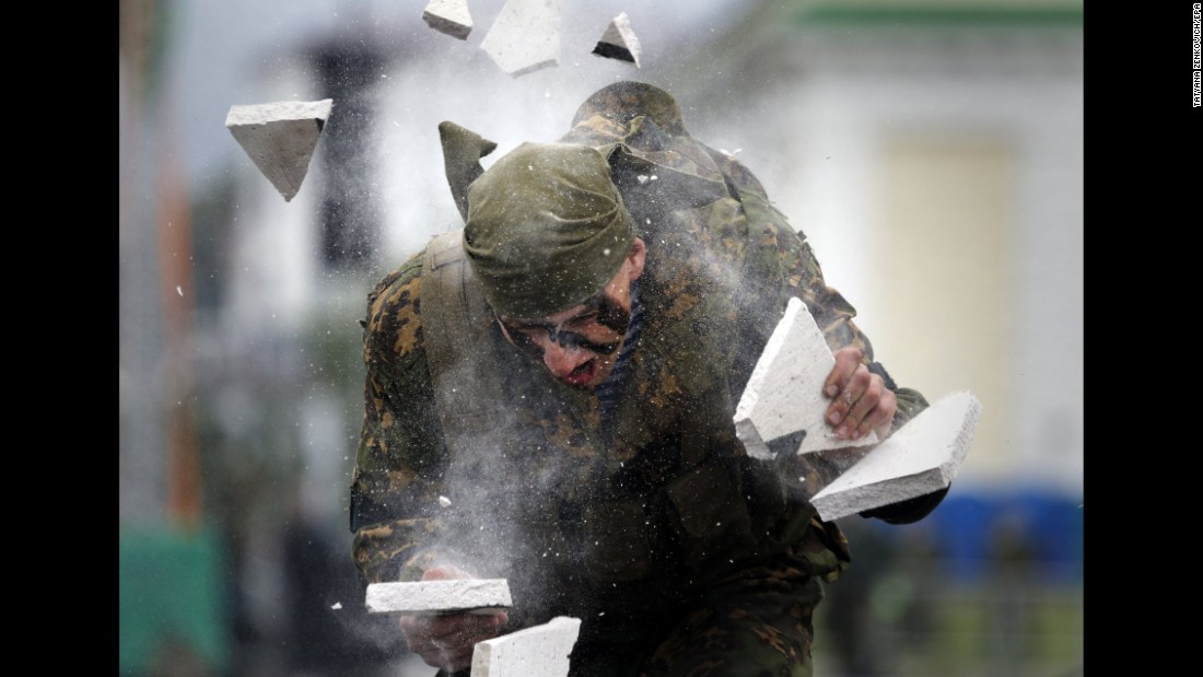 A paratrooper in Minsk, Belarus, breaks a block with his head during celebrations for Paratroopers' Day, a military holiday held annually on Wednesday, August 2.