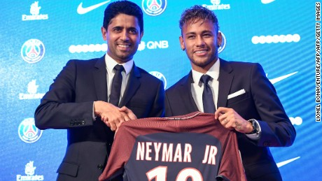"Brazilian superstar Neymar (R) poses with his jerseynext to Paris Saint Germain's (PSG) Qatari president Nasser Al-Khelaifi during a press conference at the Parc des Princes stadium on August 4, 2017 in Paris after agreeing a five-year contract following his world record 222 million euro ($260 million) transfer from Barcelona to PSG. Paris Saint-Germain have signed Brazilian forward Neymar from Barcelona for a world-record transfer fee of 222 million euros (around $264 million), more than doubling the previous record. Neymar said he came to Paris Saint-Germain for a ""bigger challenge"" in his first public comments since arriving in the French capital. / AFP PHOTO / Lionel BONAVENTURE        (Photo credit should read LIONEL BONAVENTURE/AFP/Getty Images)"