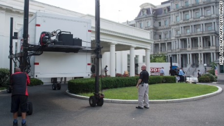 Storage containers are delivered outside the West Wing of the White House in Washington, DC, August 4, 2017, as workers prepare to complete maintenance and updates to the West Wing as US President Donald Trump travels on a 17-day vacation to Trump's golf course in Bedminster, New Jersey. / AFP PHOTO / SAUL LOEB        (Photo credit should read SAUL LOEB/AFP/Getty Images)