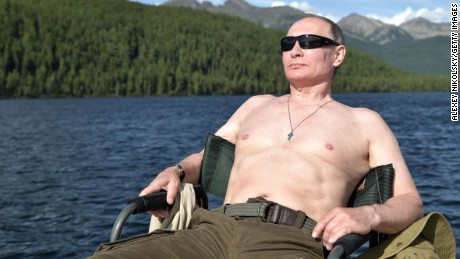 TOPSHOT - Russian President Vladimir Putin sunbathes during his vacation in the remote Tuva region in southern Siberia. The picture taken between August 1 and 3, 2017. / AFP PHOTO / SPUTNIK / Alexey NIKOLSKY        (Photo credit should read ALEXEY NIKOLSKY/AFP/Getty Images)