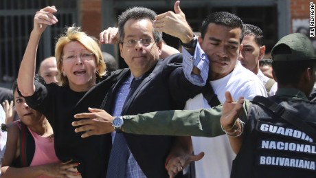 Forces bar Luisa Ortega Diaz, left, and employees from entering the attorney general's office Saturday.