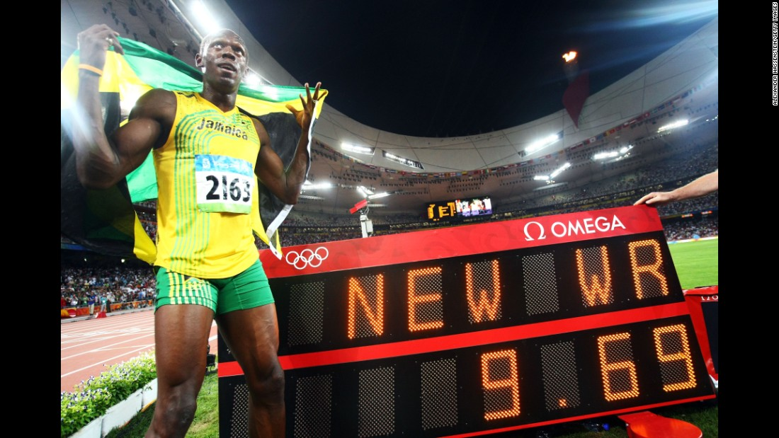 Bolt celebrates next to the scoreboard after winning the men's 100-meter in Beijing.