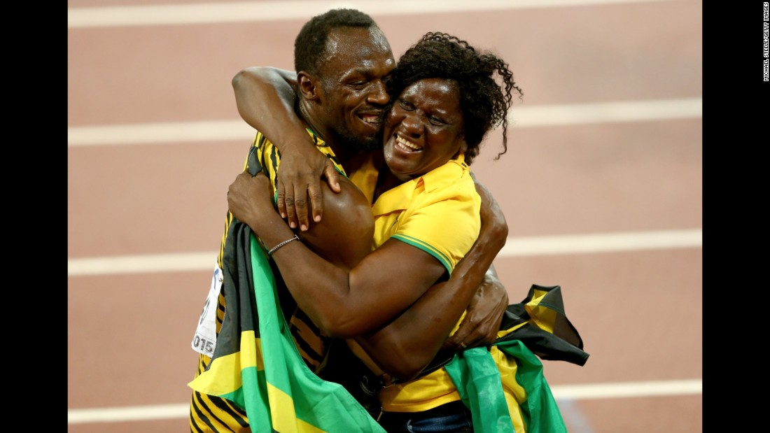 Bolt celebrates with his mother, Jennifer, after winning 100-meter gold at the 2015 World Championships in Beijing.
