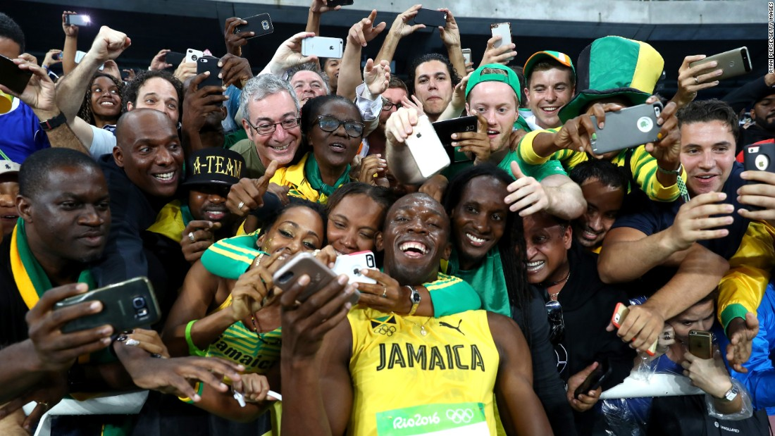 "Bolt celebrates with fans after winning the 200-meter at the 2016 Olympics. In Rio, Bolt completed an unprecedented ""triple-triple"": three straight Olympic golds in the 100-meter, the 200-meter and the 4x100 relay. In 2017, Bolt was stripped of his 2008 relay medal after it was confirmed that teammate Nesta Carter tested positive for a banned substance."