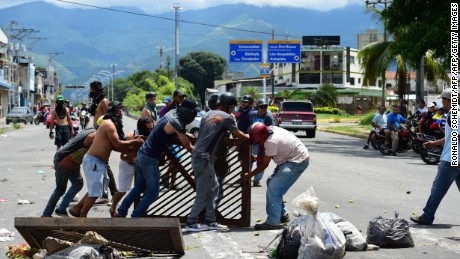 "Anti-government activists set up a barricade in the streets of Venezuela's third city, Valencia, on August 6, 2016, a day after a new assembly with supreme powers and loyal to President Nicolas Maduro started functioning in the country. In the video posted online earlier, allegedly at an army base used by the National Bolivarian Armed Forces in Valencia, a man presenting himself as an army captain declared a ""legitimate rebellion... to reject the murderous tyranny of Nicolas Maduro"" and demanded a transitional government and ""free elections."" After the video surfaced, military chiefs said troops had put down the ""terrorist"" attack.   / AFP PHOTO / Ronaldo SCHEMIDTRONALDO SCHEMIDT/AFP/Getty Images"