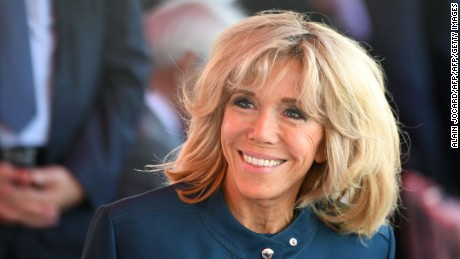 Brigitte Macron (C), wife of French President, smiles ahead of the start of the annual Bastille Day military parade on the Champs-Elysees avenue in Paris on July 14, 2017.  / AFP PHOTO / ALAIN JOCARD        (Photo credit should read ALAIN JOCARD/AFP/Getty Images)