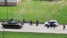 Soldiers stop a vehicle and detain its passengers on the Paramacay military base in Valencia, Venezuela, on August 6. According to authorities, two people were killed when <a href=