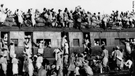 Hundreds of Muslim refugees crowd atop a train leaving New Delhi for Pakistan in this September 1947 file photo. India will celebrate its 50th anniversary of Independence from Britian on Friday Aug. 15, 1997. The day also marks the division of the British empire into officially Muslim Pakistan and largely Hindu India. That division was accompanied by bloody religious riots in 1947, the memories of which haunt freedom celebrations. (AP Photo)