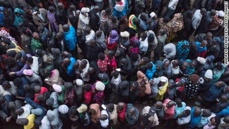 Voters line up at a station in Kibera.