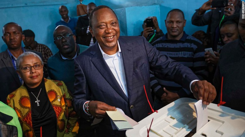 Kenyatta casts his vote alongside his wife Margaret on Tuesday.