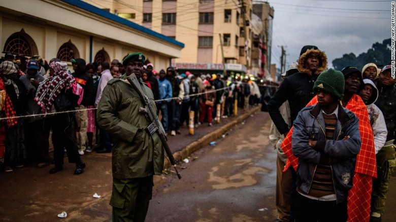 Kenyans wait to cast their ballot at a polling station in the Rift Valley town of Eldoret on August 8.