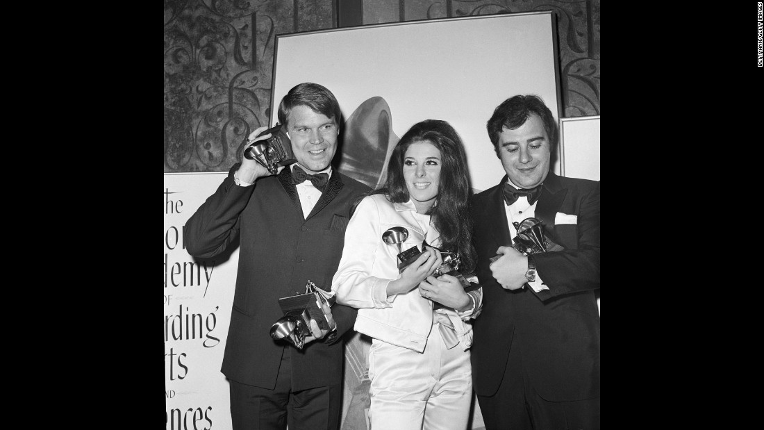 Campbell, Bobbie Gentry and Lalo Schifrin hold the statuettes they won at the 1968 Grammy Awards. Campbell won four Grammys that year.