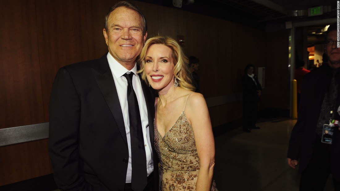 Campbell and his fourth wife, Kim Woollen, attend the Grammy Awards in 2012.