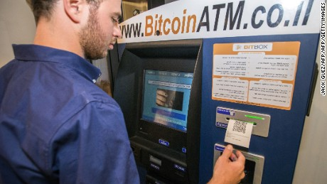A Israeli man buys Bitcoins at the first Bitcoin ATM machine installed in the Middle East on June 11, 2014 at the Town-House TLV hotel in the Mediterranean coastal city of Tel Aviv. Bitcoin is a form of cryptography-based e-money that can be stored either virtually or on a user's hard drive, and offers a largely anonymous payment system. AFP PHOTO / JACK GUEZ        (Photo credit should read JACK GUEZ/AFP/Getty Images)