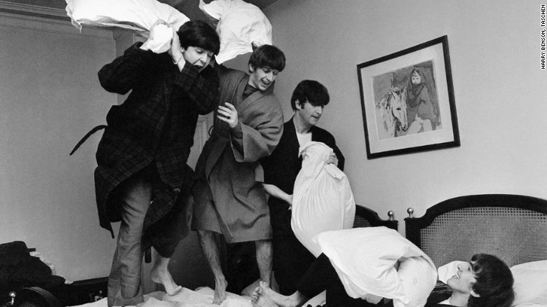 """They weren't keen at first,"" writes photographer Harry Benson of when he put the idea for this photo to the Beatles. ""John said it would make them look childish, then he hit Paul in the back of the head with the pillow and it went from there."""