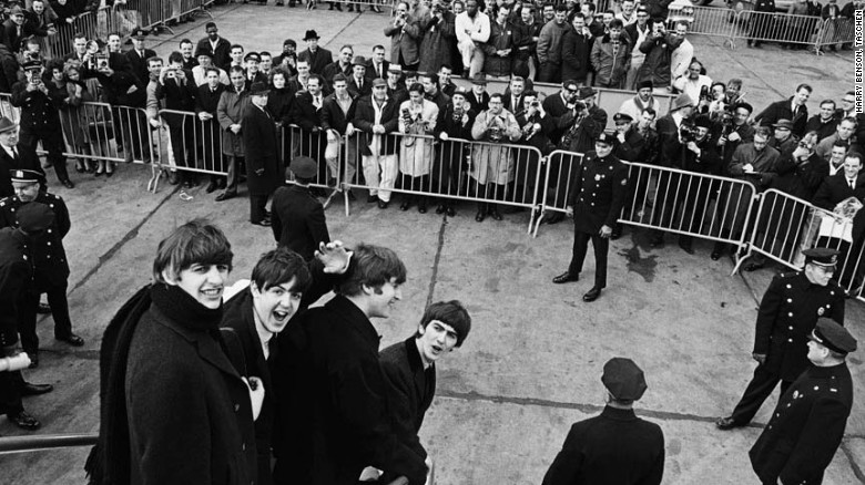 "The enormity of the Beatles fame really hit home when they touched down in the US and were greeted by thousands of screaming fans. ""As they got off the plane, I was right behind them, and then Ringo reminded them to turn around and smile at me as we had planned,"" Benson writes."