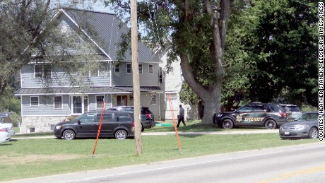 Sauk County Sheriff's Office investigators examine the scene of a fatal shooting Aug. 8 south of Loganville.