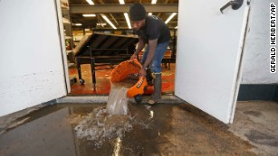New Orleans braces for more rain as city works to clean up flood fallout