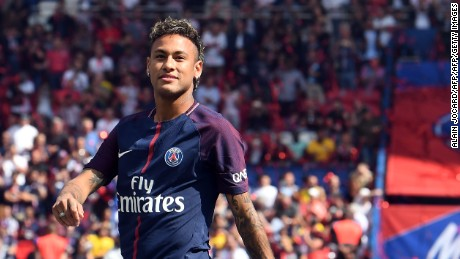 Paris Saint-Germain's Brazilian forward Neymar looks on during his presentation to the fans at the Parc des Princes stadium in Paris on August 5, 2017.  Brazil superstar Neymar will watch from the stands as Paris Saint-Germain open their season on August 5, 2017, but the French club have already clawed back around a million euros on their world record investment. Neymar, who signed from Barcelona for a mind-boggling 222 million euros ($264 million), is presented to the PSG support prior to his new team's first game of the Ligue 1 campaign against promoted Amiens. / AFP PHOTO / ALAIN JOCARD        (Photo credit should read ALAIN JOCARD/AFP/Getty Images)