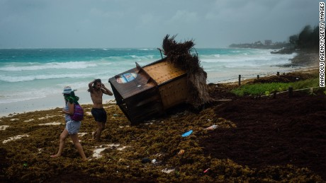 People are seen near a knocked down booth after tropical storm Franklin hit Tulum, Mexico on August 08, 2017. Franklin is heading for the Gulf of Mexico and is expected to hit Veracruz after become a hurricane.