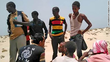 IOM staff assist Somali, Ethiopian migrants who were forced into the sea by smugglers.