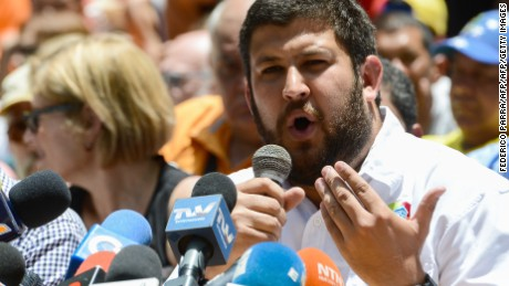 Hatillo's Mayor David Smolansky speaks next to other opposition mayors during a press conference at Bolivar square in the Chacao neighborhood in Caracas, on May 25, 2017. / AFP PHOTO / FEDERICO PARRA        (Photo credit should read FEDERICO PARRA/AFP/Getty Images)