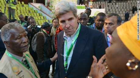 "Former US Secretary of State, John Kerry (C) talks with former South Africa president and African Union observer Thabo Mbeki (L) and an independent observer at the national tally centre on August 9, 2017 in Nairobi as final results for Kenya's presidential elections are anticipated.  President Uhuru Kenyatta appeared headed for re-election Wednesday as his rival Raila Odinga rejected early results as ""fake"", setting nerves on edge in east Africa's richest economy. With ballots from 90 percent of polling stations counted, electoral commission (IEBC) results showed Kenyatta leading with 54.6 percent of the nearly 13 million ballots tallied against Odinga's 44.5 percent, a difference of 1.3 million votes.  / AFP PHOTO / TONY KARUMBA        (Photo credit should read TONY KARUMBA/AFP/Getty Images)"