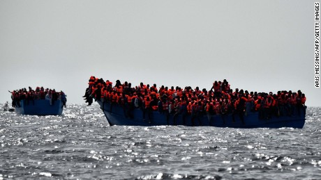 Migrants wait to be rescued as they drift in the Mediterranean Sea off the coast of Libya in October 2016.
