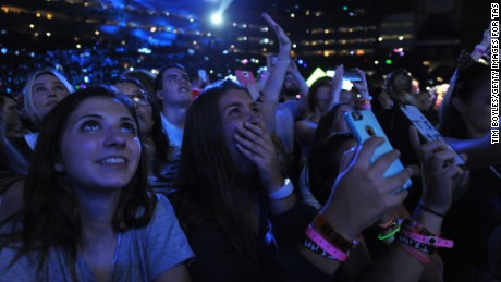 "Fans react to Taylor Swift as she performs on her ""The 1989 World Tour"" at Raymond James Stadium on October 31, 2015 in Tampa, Florida."
