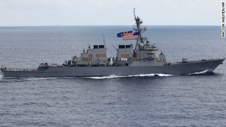 In this photo taken Saturday, Aug. 13, 2011, the USS John S. McCain (DDG-56) destroyer sails off the coast of Vietnam. A Navy official says the USS John S. McCain has sailed close to a Chinese man-made island in a freedom of navigation operation in the disputed South China Sea.