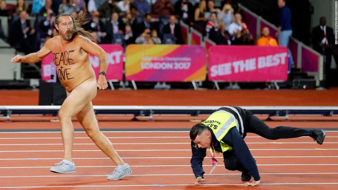 A steward chases a streaker in London that ran onto the track at the World Championships on Saturday, August 5.