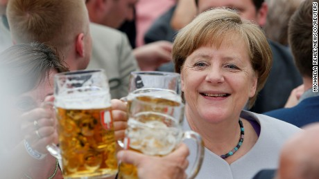German Chancellor and head of the Christian Democratic Union Angela Merkel toasts during the Trudering festival in Munich, Germany, May 28, 2017.