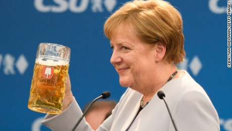 MUNICH, GERMANY - MAY 28: German Chancellor and Chairwoman of the German Christian Democrats (CDU) Angela Merkel holds a beer mug after her speech at the Trudering fest on May 28, 2017 in Munich, Germany. The CDU and CSU, along with the German Social Democrats (SPD), form the current German coalition government, though relations between Merkel and Seehofer have been complicated as the two have clashed over certain issues, especially immigration.  (Photo by Sebastian Widmann/Getty Images)