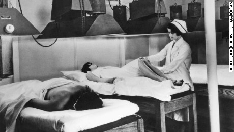 "The Kellogg's Battle Creek Sanitarium urged ""wellness"" through controlled diets and therapies such as artificial sunlight treatment, shown around 1924."