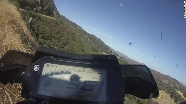 Motorcyclist survives driving off cliff