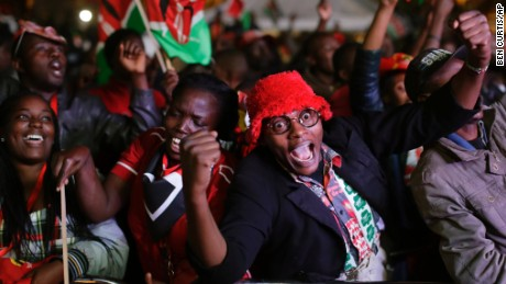 Supporters of Kenya's President Uhuru Kenyatta cheer as they hear the election results, downtown Nairobi, Kenya,  Friday, Aug. 11, 2017.  Opposition candidate Raila Odinga claimed the vote was rigged.