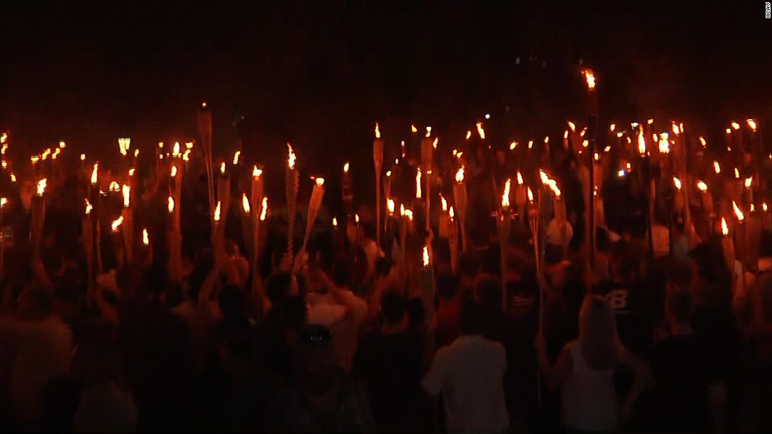 Torch-bearing white nationalists march ahead of alt-right rally