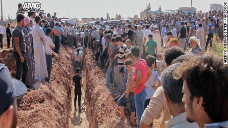 People gather for the funeral of members of the Syrian Civil Defense in Idib province on August 12.