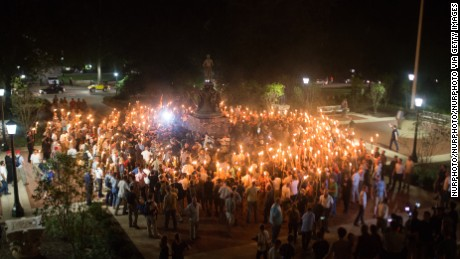 White Supremacists encircle counter protestors at the base of a statue of Thomas Jefferson after marching through the University of Virginia campus with torches in Charlottesville, Va., USA on August 11, 2017. (Photo by Zach D Roberts/NurPhoto via Getty Images)