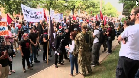 "Counter-protesters gather in Charlottesville, Virginia, on Saturday morning ahead of a ""Unite the Right"" rally."