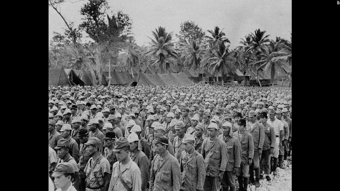 Some of the 2,600 Japanese prisoners of war, who comprised the enemy garrison on the island of Rota, are lined up in a POW stockade on nearby Guam, in the Mariana Islands, September 5, 1945.