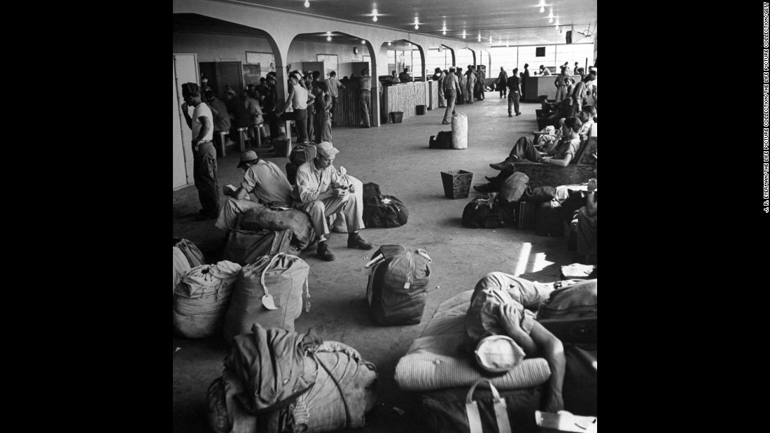 Sailors wait inside a US Navy air terminal building at Agana Field on Guam.