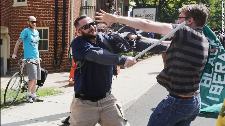 "White nationalists, neo-Nazis and members of the ""alt-right"" clash with counter-protesters in the street after the ""Unite the Right"" rally was delcared a unlawful gathering by Virginia State Police August 12, 2017 in Charlottesville, Virginia. After clashes with anti-fascist protesters and police the rally was declared an unlawful gathering and people were forced out of Lee Park, where a statue of Confederate General Robert E. Lee is slated to be removed."
