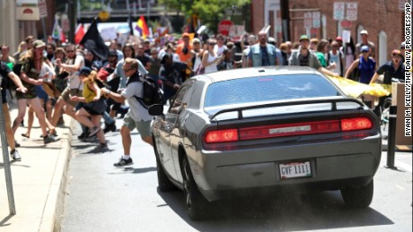 A vehicle drives into a group of protesters demonstrating against a white nationalist rally in Charlottesville, Virginia on Saturday, August 12, 2017. The nationalists were holding the rally to protest plans by the city of Charlottesville to remove a statue of Confederate Gen. Robert E. Lee. There were several hundred protesters marching in a long line when the car drove into a group of them.